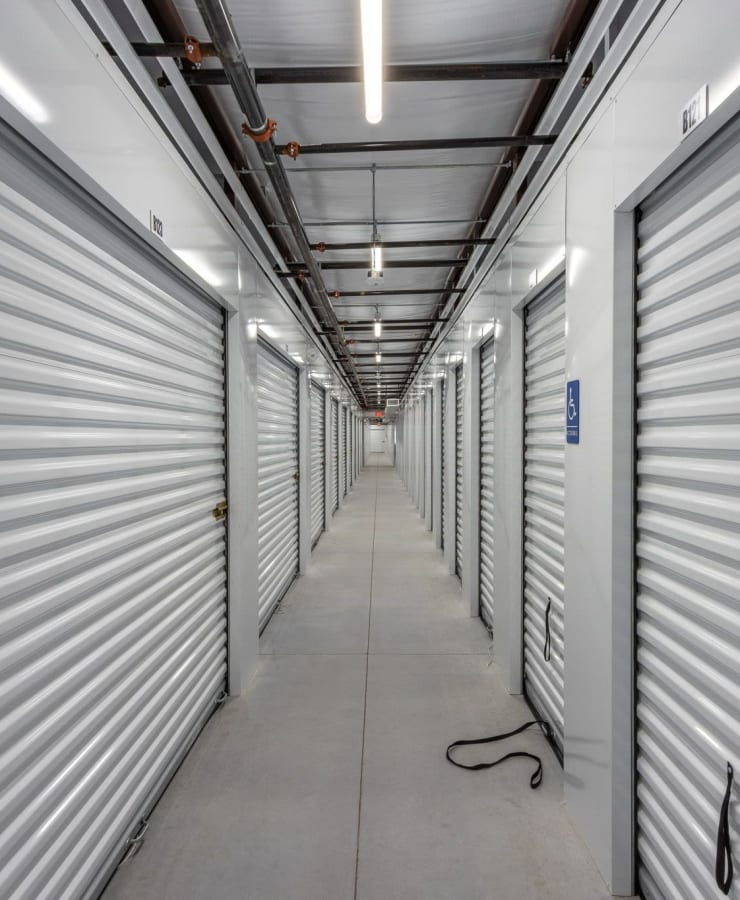 hallway lined with units at StorQuest Express Self Service Storage in Cape Coral, Florida
