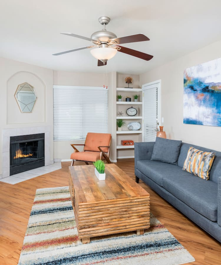 Model living room with hardwood flooring at San Marin at the Civic Center