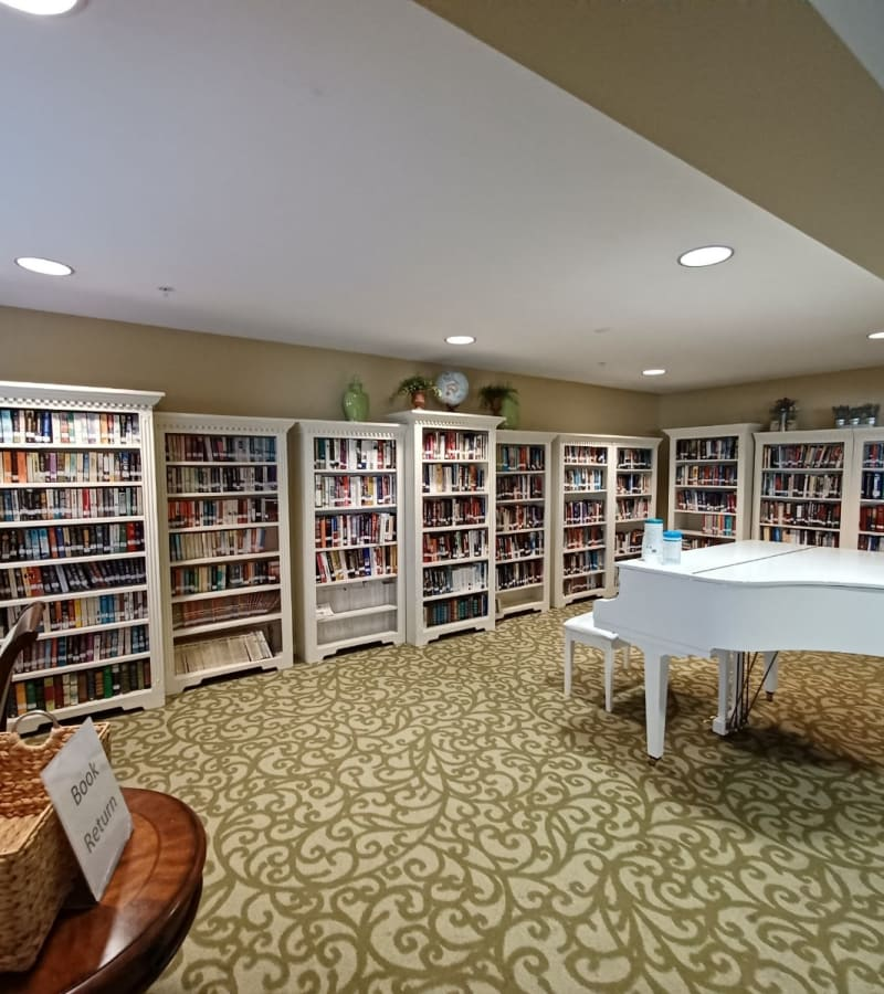 Study with books and piano at Pacifica Senior Living Menifee in Sun City, California.