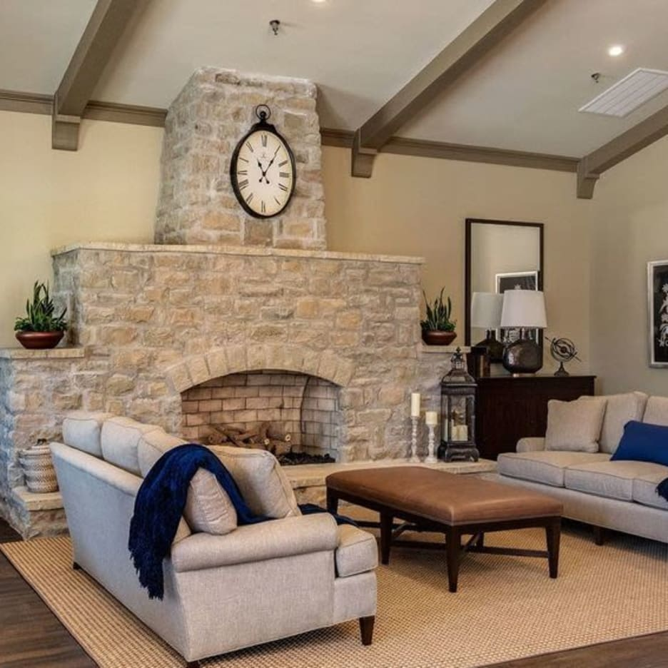 The fireplace in the clubhouse at Boulders at Overland Park Apartments in Overland Park, Kansas
