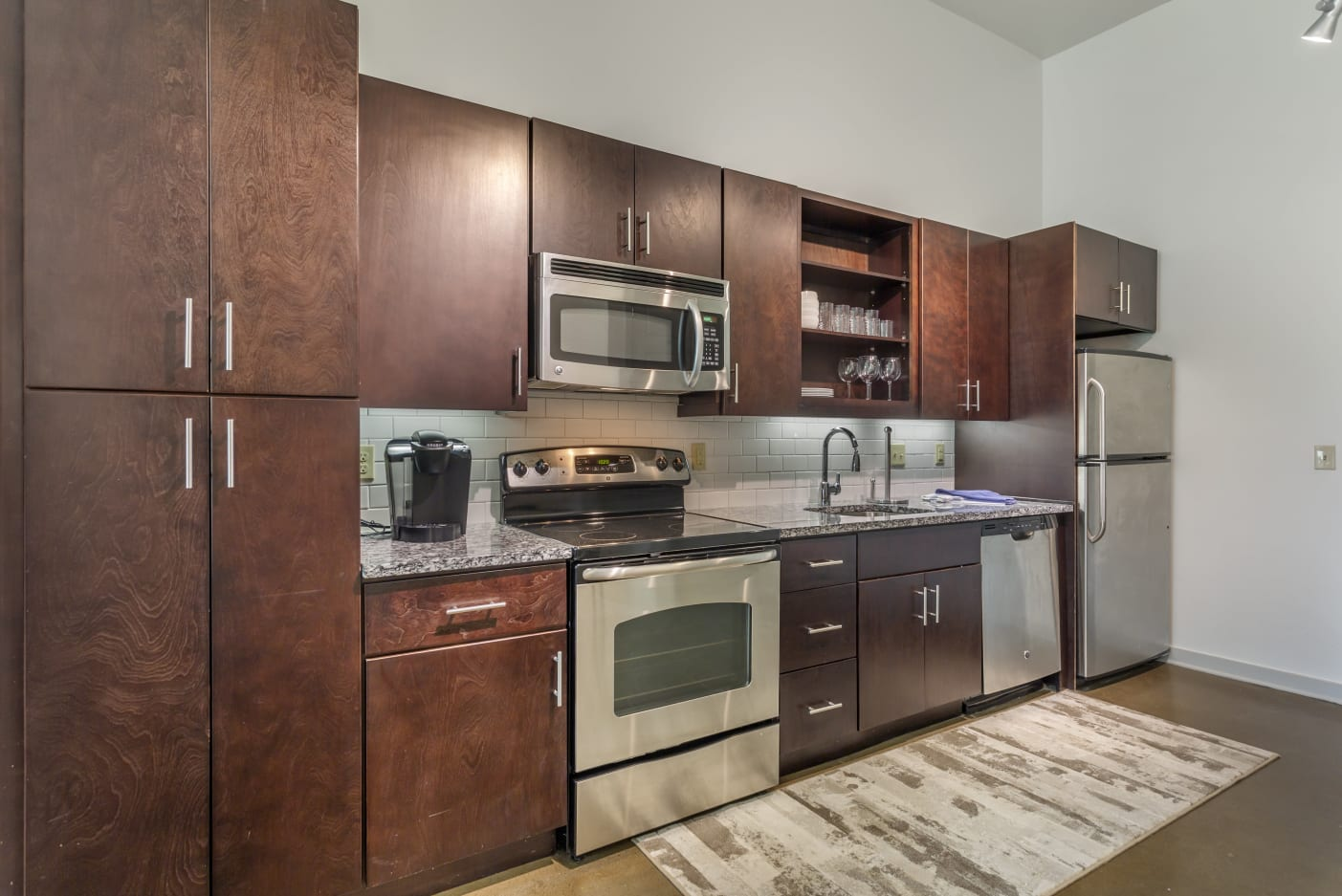 Kitchens with stainless steel appliances at 12 South Apartments