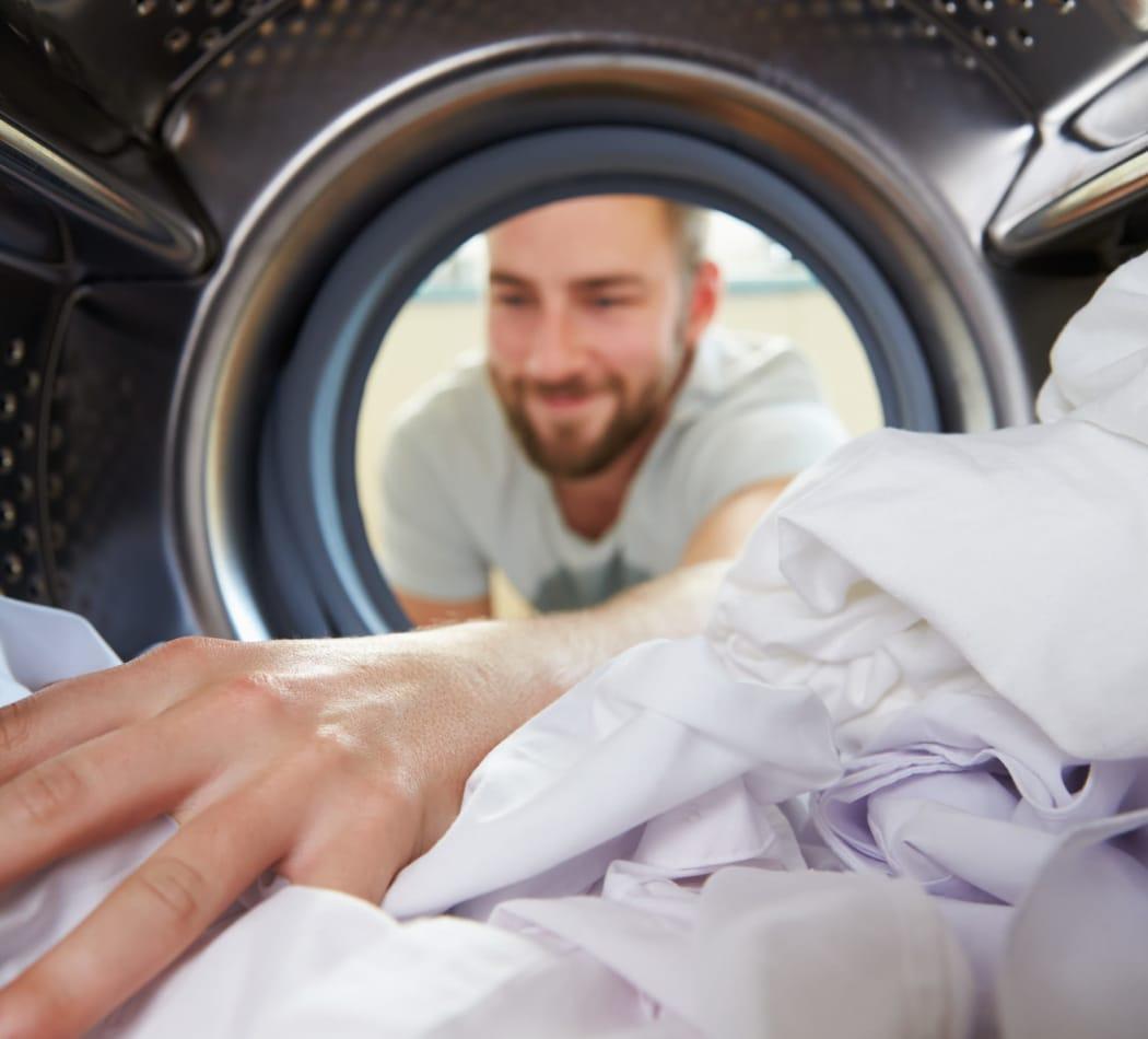 Resident doing laundry at LaFayette Gardens