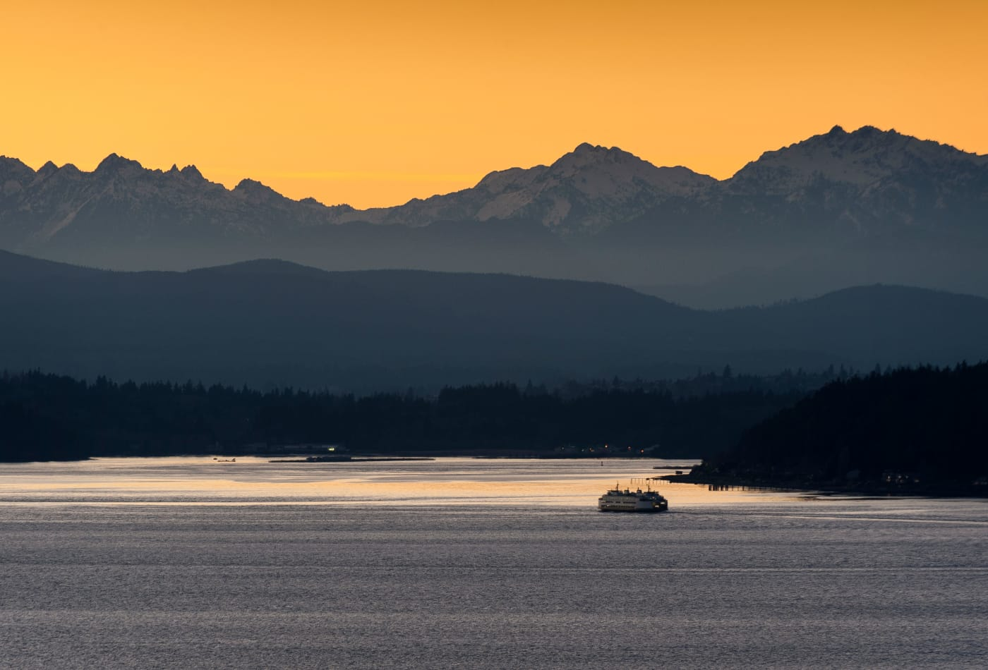 Sun setting behind mountains in Bremerton, WA