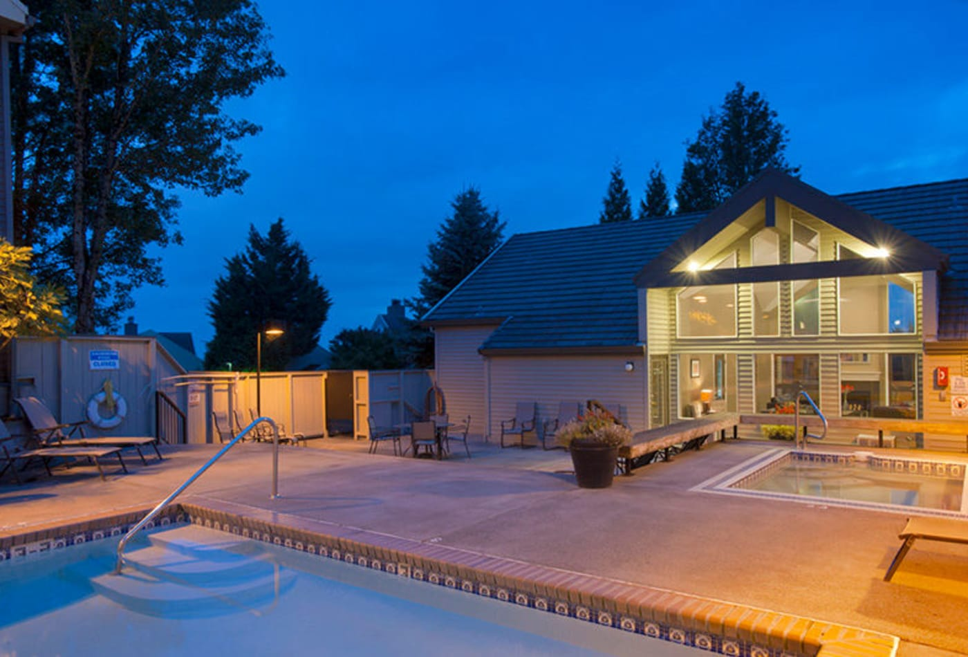 Exterior view of the clubhouse and swimming pool in the evening at MiLO at Mountain Park