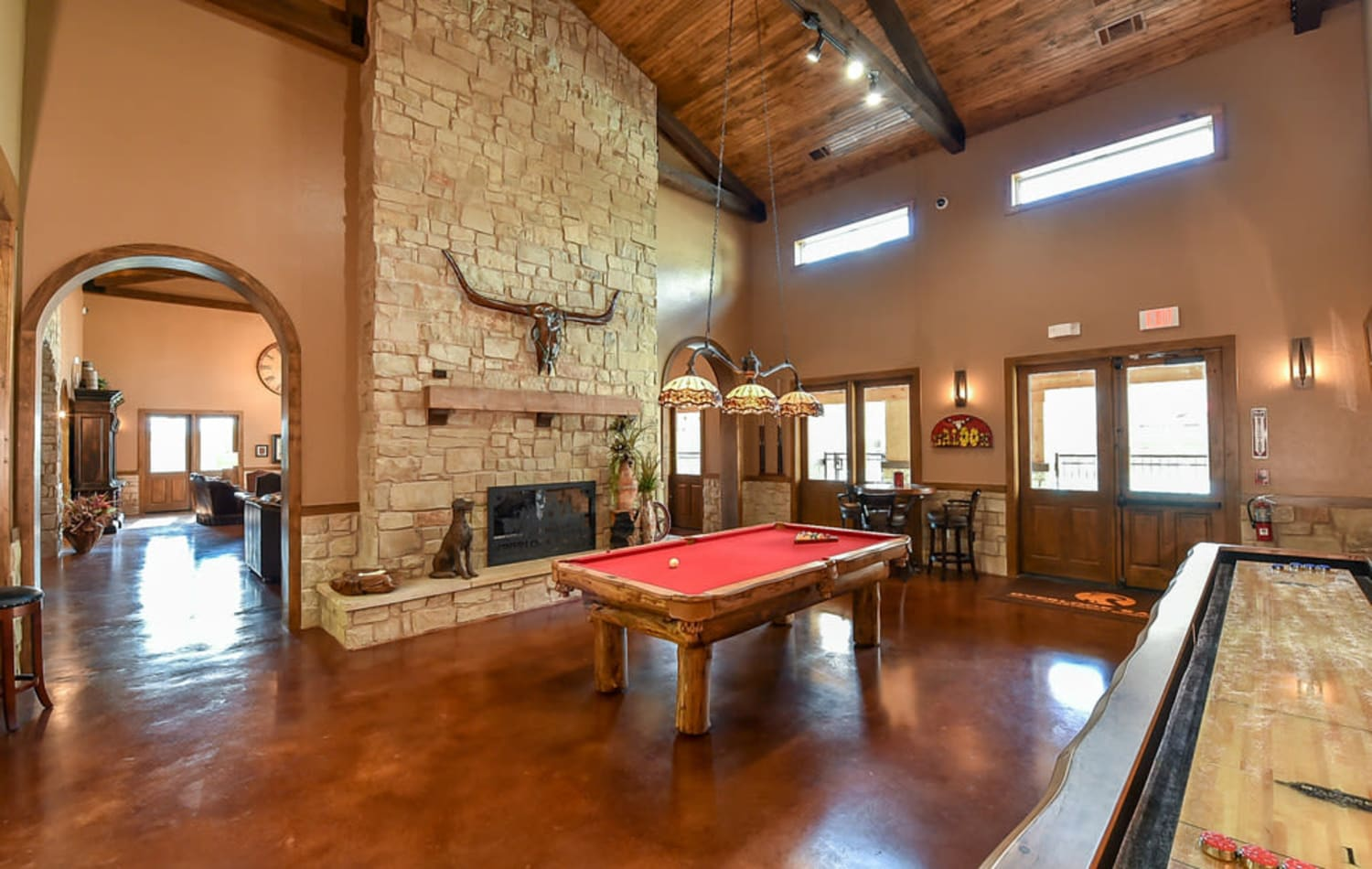 The clubhouse with pool table at Overlook Ranch in Fort Worth, Texas