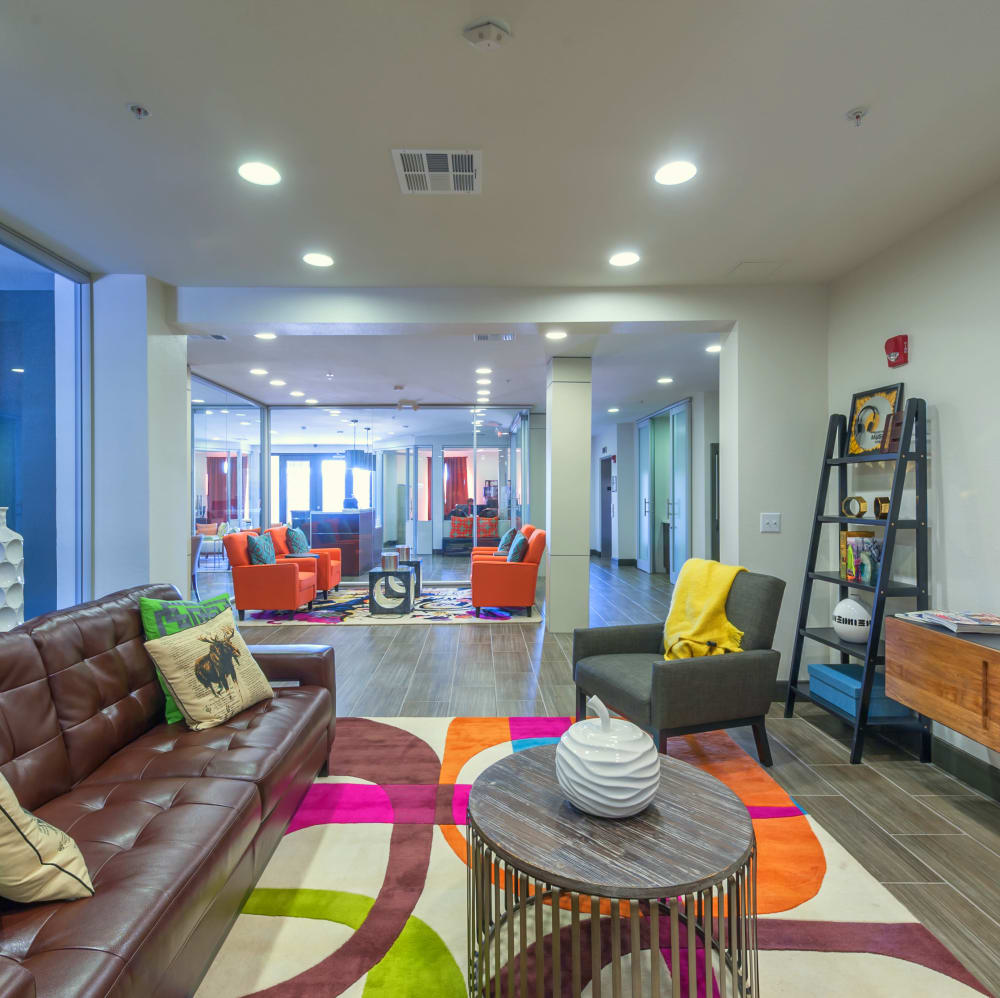Community clubhouse lounge with couches at The JaXon in Kingwood, Texas