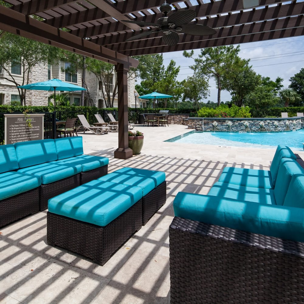 Shaded lounge with comfortable couches at Lakefront Villas in Houston, Texas