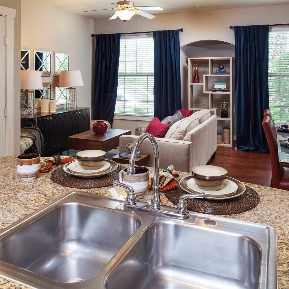 Open floor plan concept with wood flooring and large windows at Lakefront Villas in Houston, Texas