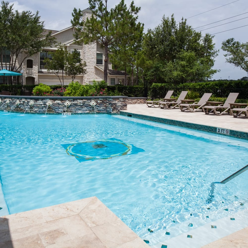 Sundeck with plenty of lounge chairs at Lakefront Villas in Houston, Texas