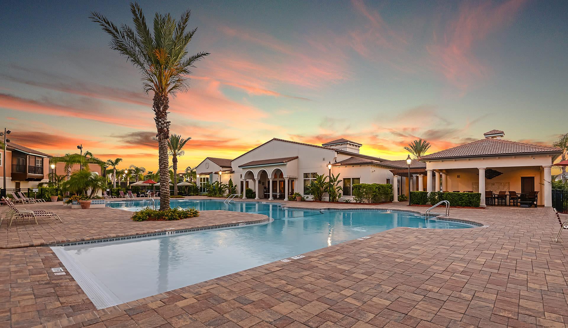 Swimming pool area at twilight at Hacienda Club in Jacksonville, Florida