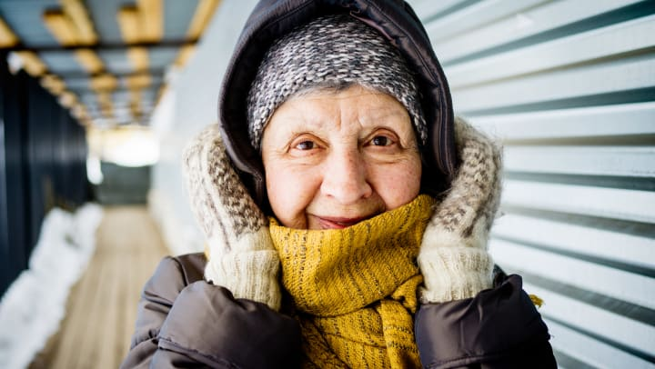 Smiling senior woman dressed for cold weather.