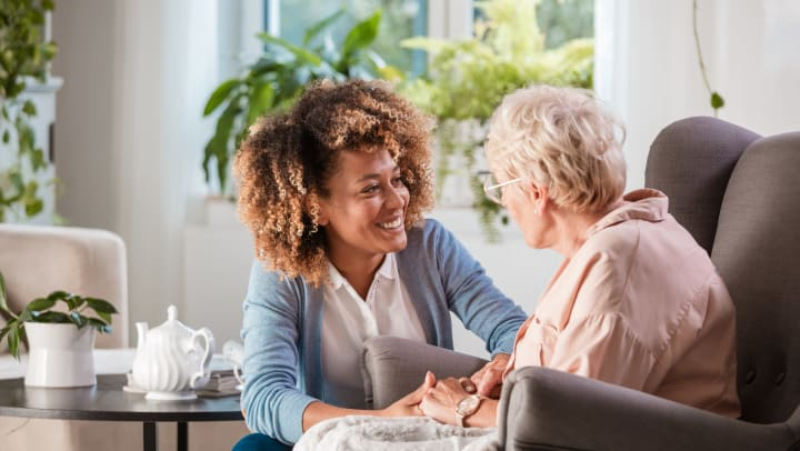 Caregiver smiling at senior woman