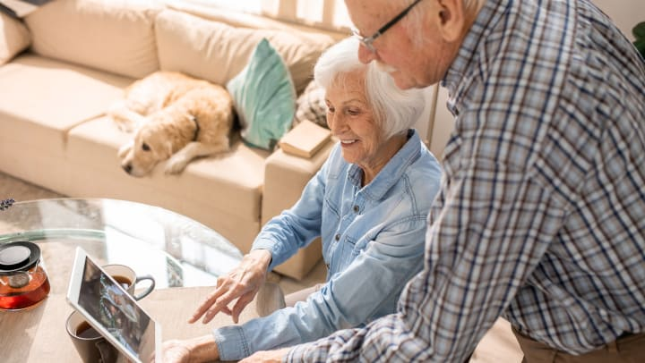 Image of older couple video chatting.