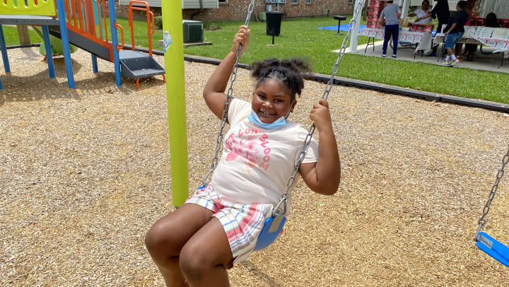Girl plays on new Playground at Summerfield Apartment Homes