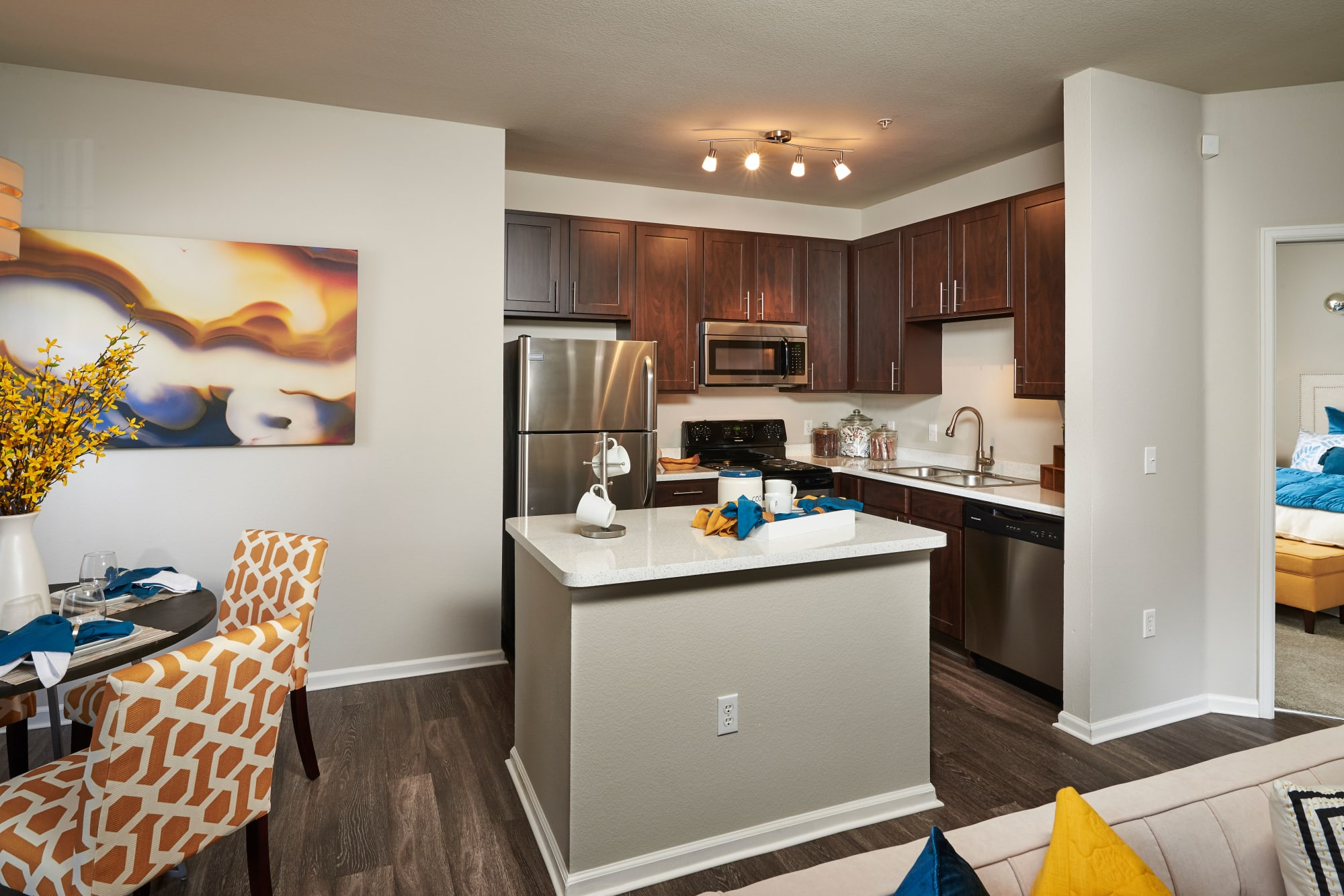 Newly renovated kitchen with espresso cabinetry at Bear Valley Park in Denver, Colorado