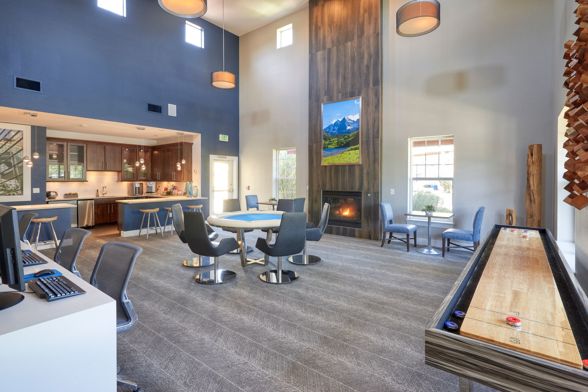 Luxury clubhouse complete with a pool table, shuffleboard, a kitchen, and a business center at Bear Valley Park in Denver, Colorado