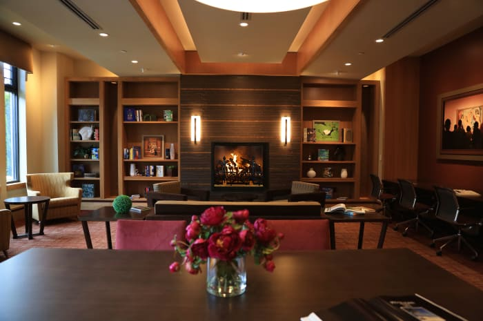 Cozy fireplace in the library at All Seasons of Birmingham in Birmingham, Michigan
