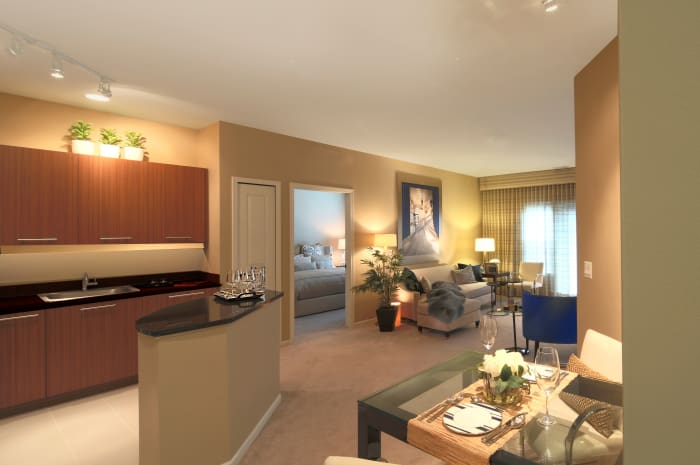 Model living room and kitchen at All Seasons of Birmingham in Birmingham, Michigan