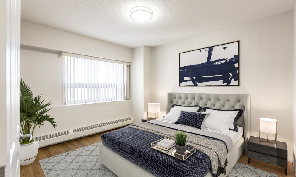Park Square showcases a cozy bedroom in Edmonton apartments