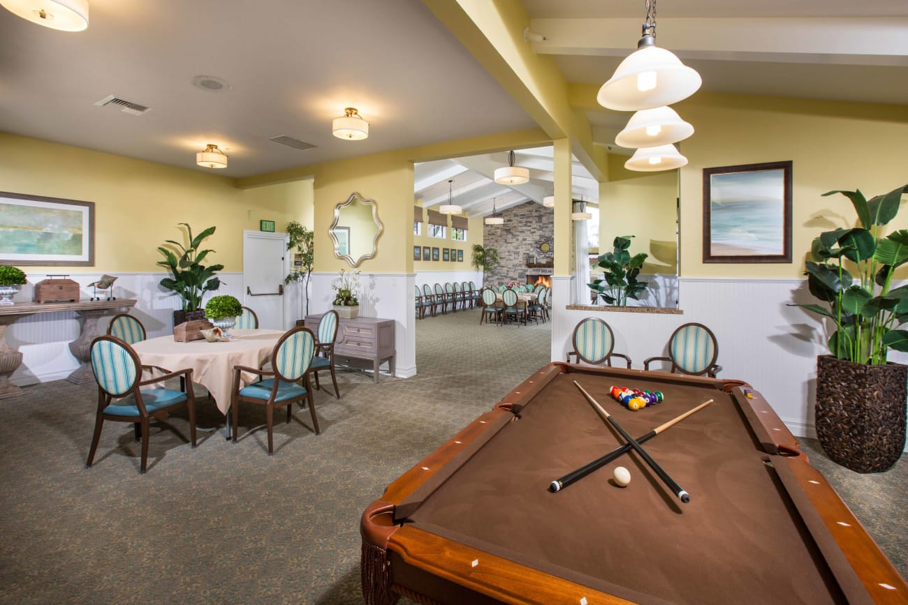 Gaming room with pool table at Huntington Terrace in Huntington Beach, California