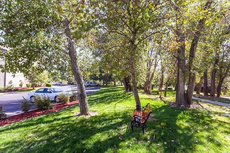 Park bench near apartments at Stonebridge at Twin Peaks