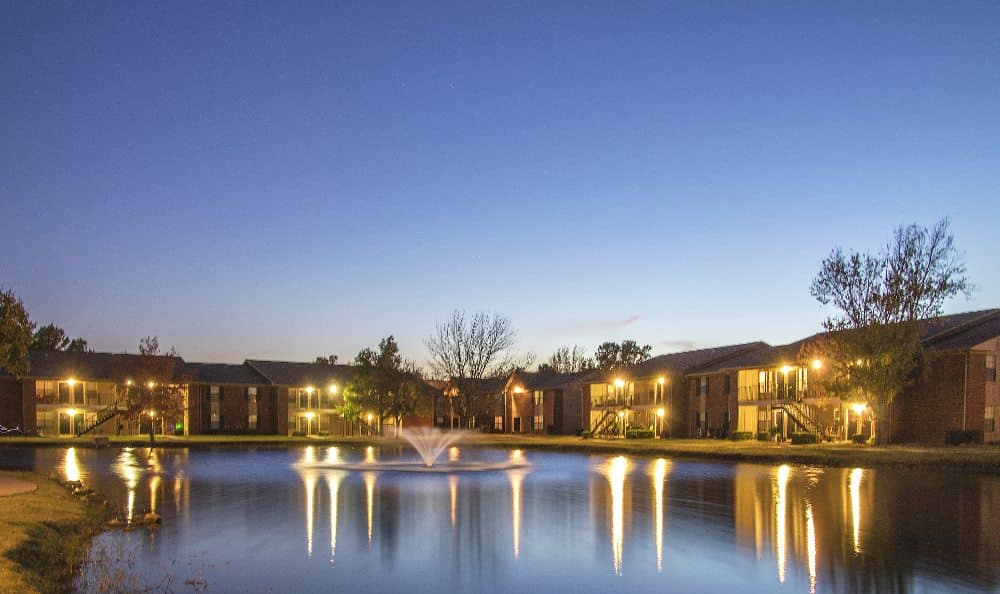Lake and apartment buildings at night at Waters Edge in Oklahoma City