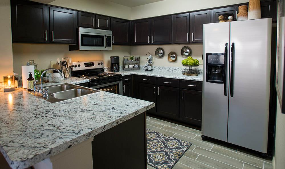 A view of the kitchen inside apartments at Icon at Broken Arrow