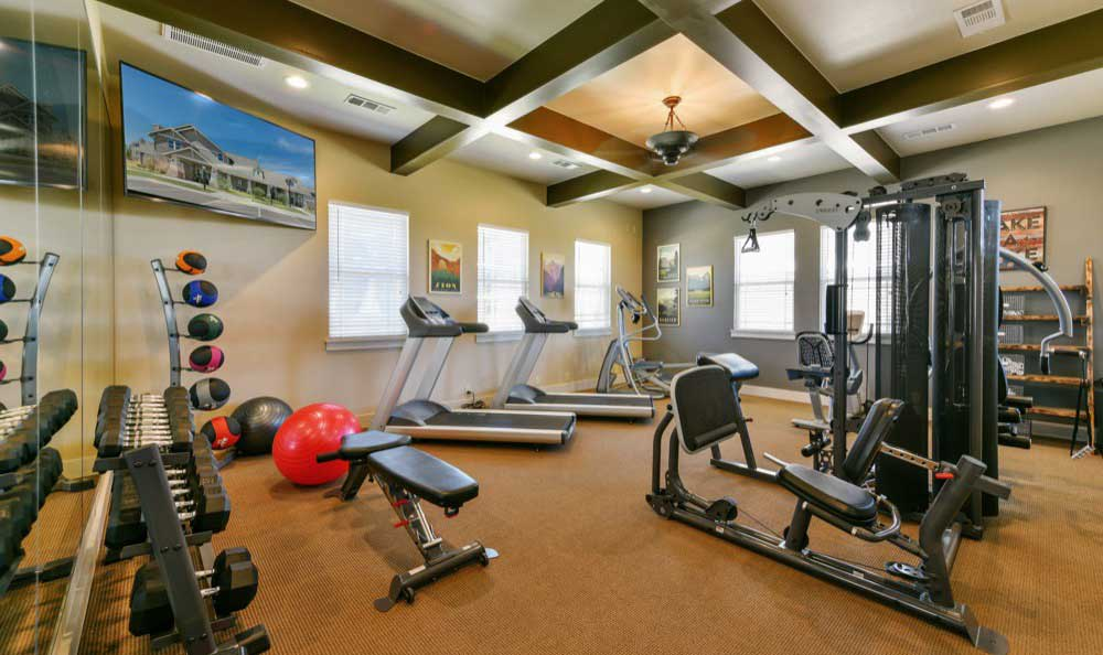 Fitness equipment at Cottages at Abbey Glen Apartments in Lubbock, TX