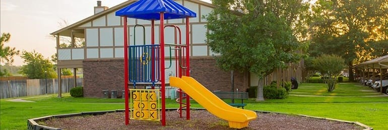 children's play structure at tulsa apartments