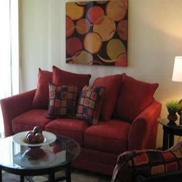 A cozy red couch at our apartments in Tulsa