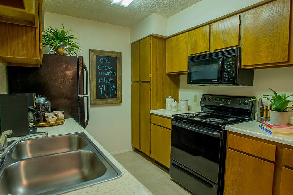 Prepare meals in this spacious kitchen in Tulsa apartments