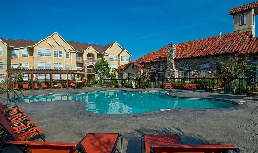 Relax by the pool at Coffee Creek Apartments
