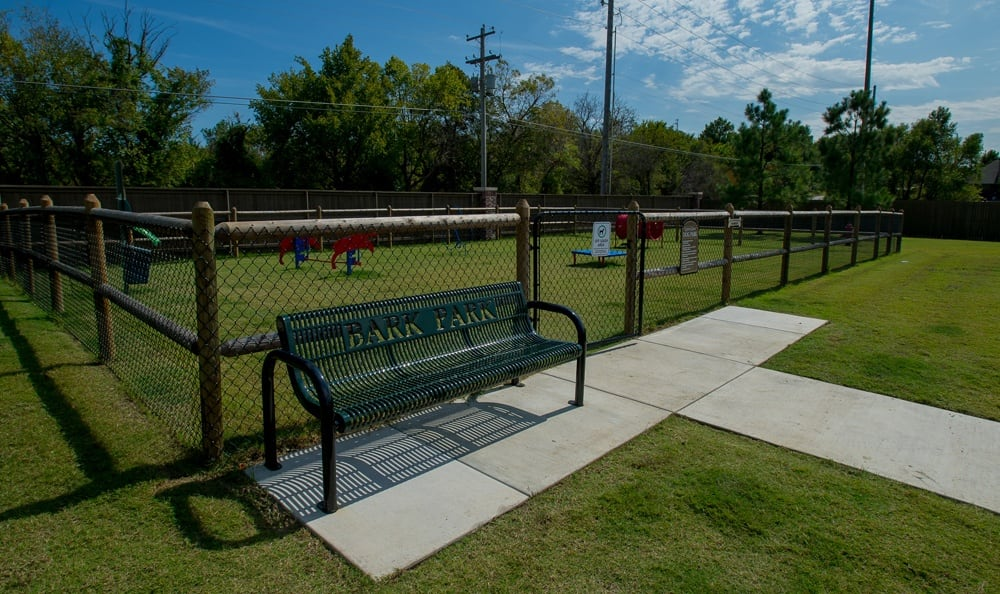 Nice bench for dog park at apartments in Owasso OK