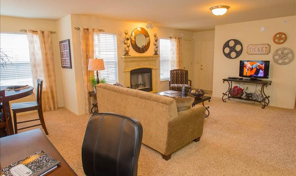 Bright living room at apartments in Owasso with a fireplace