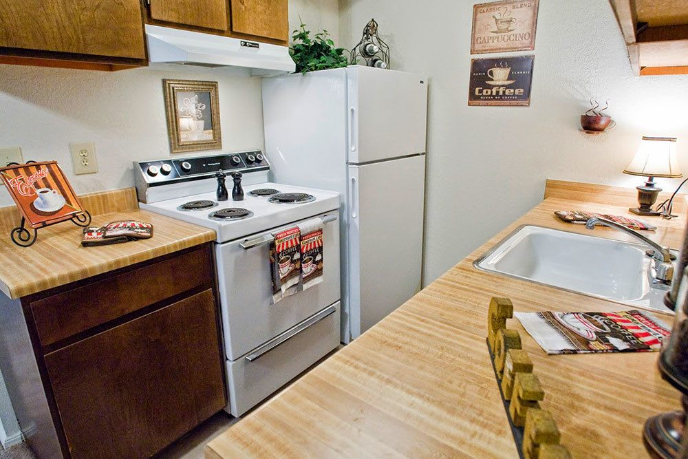 Cozy kitchen at apartments Eagle Point Apartments in Tulsa, OK