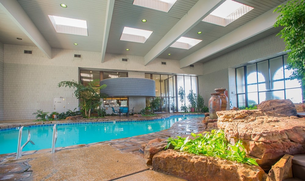 Indoor Pool with Landscaping at Sunchase Apartments