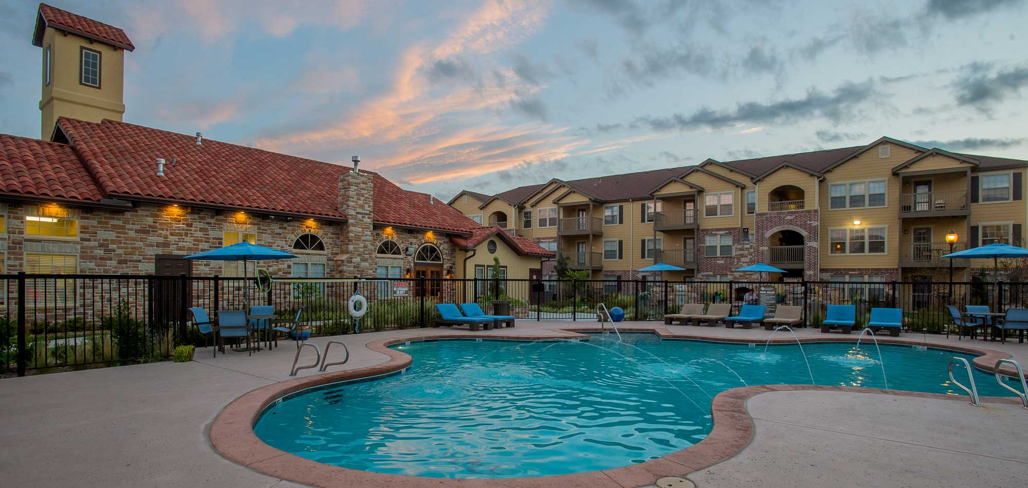 The sparkling swimming pool at our apartments in Wichita will enchant you