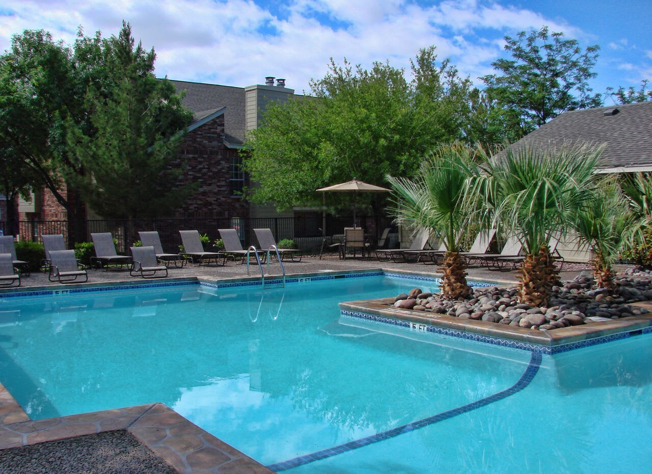 The sparkling swimming pool at our apartments in El Paso will enchant you