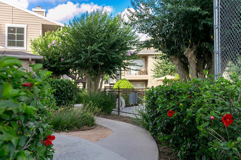 Beautifully landscaped pathway at Walnut Ridge Apartments