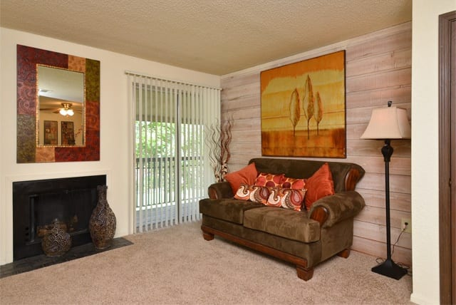 Couch and fireplace at Aspen Park Apartments