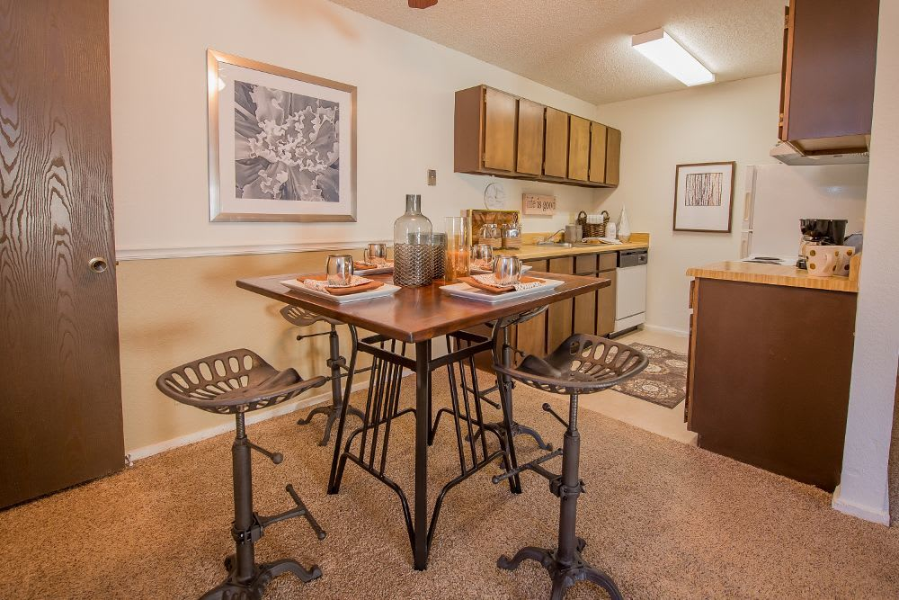 Table and kitchen at Fox Run Apartments