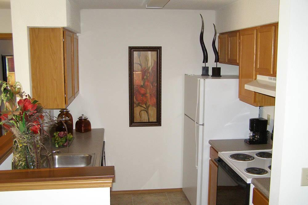 Kitchen view at Huntington Park Apartments in Wichita