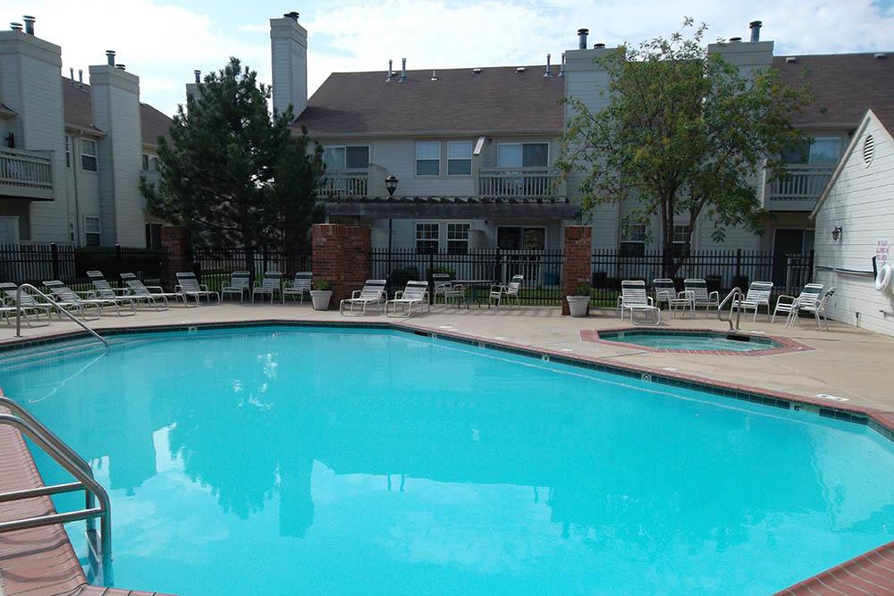 Take a dip in our pool at Huntington Park Apartments