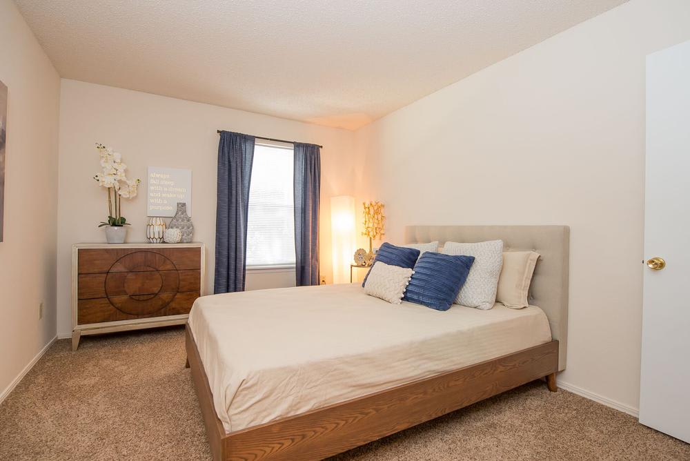 Beautiful bedroom at Raintree Apartments in Wichita, Kansas