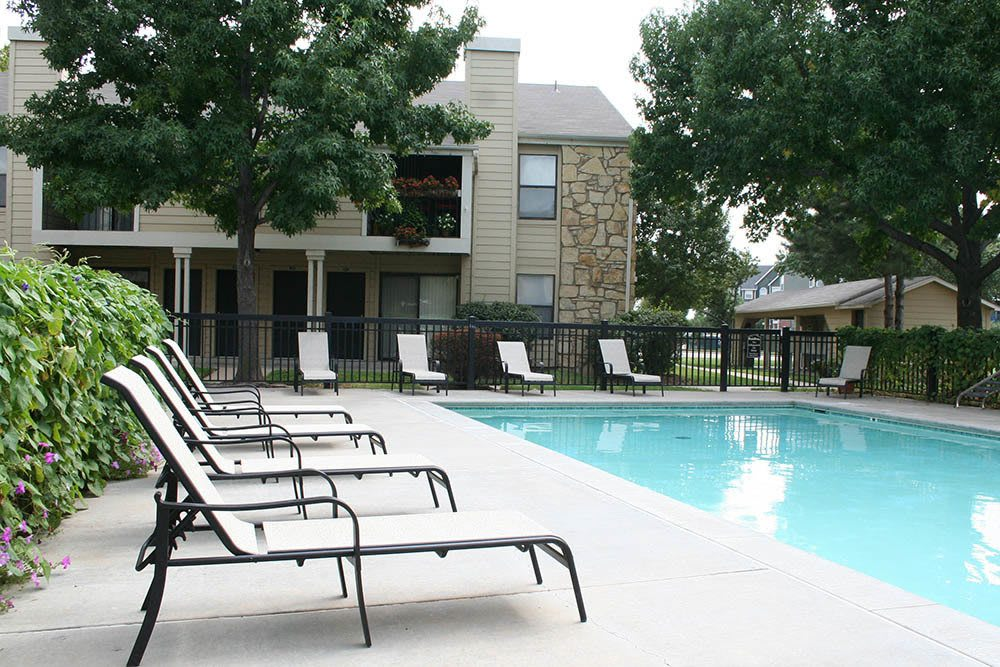 Relax in the sun by our sparkling swimming pool at Raintree Apartments