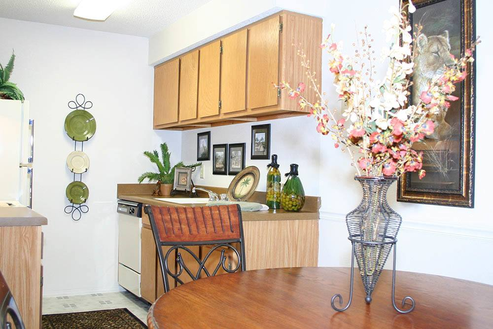 Dining table with kitchen view at Silver Springs Apartments