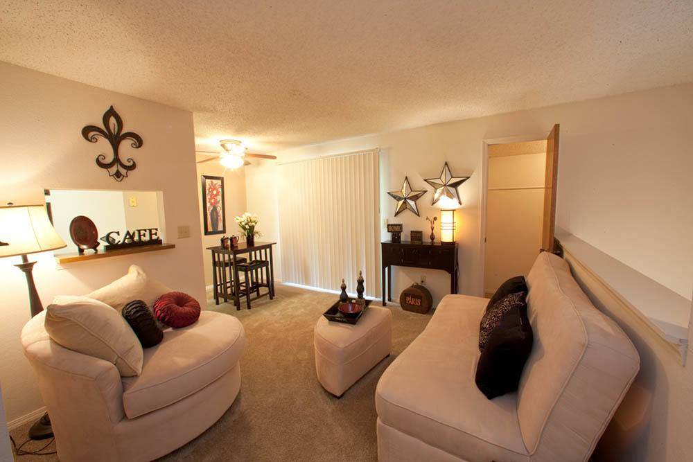 Nicely decorated living room at Silver Springs Apartments in Wichita, KS