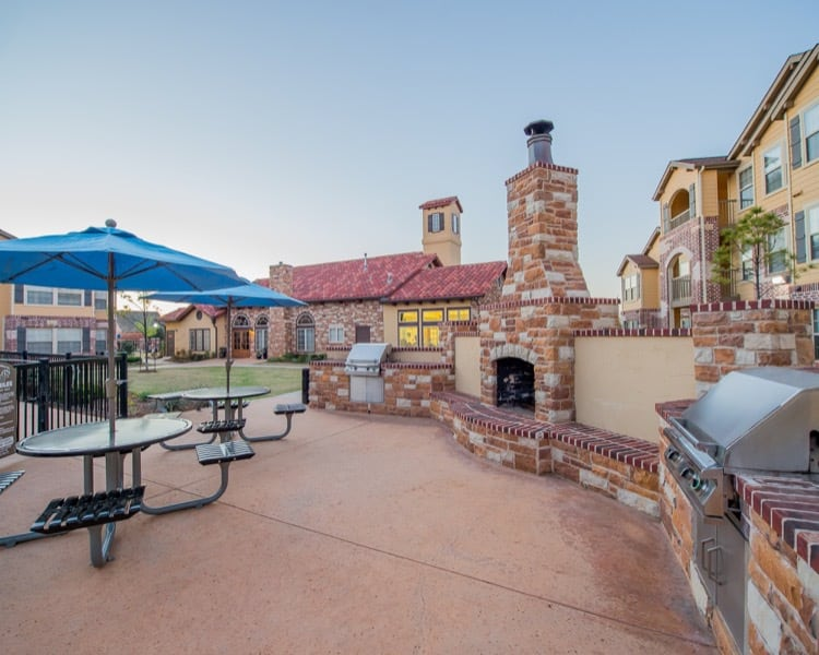 Outdoor barbecue lounge at apartments in Yukon