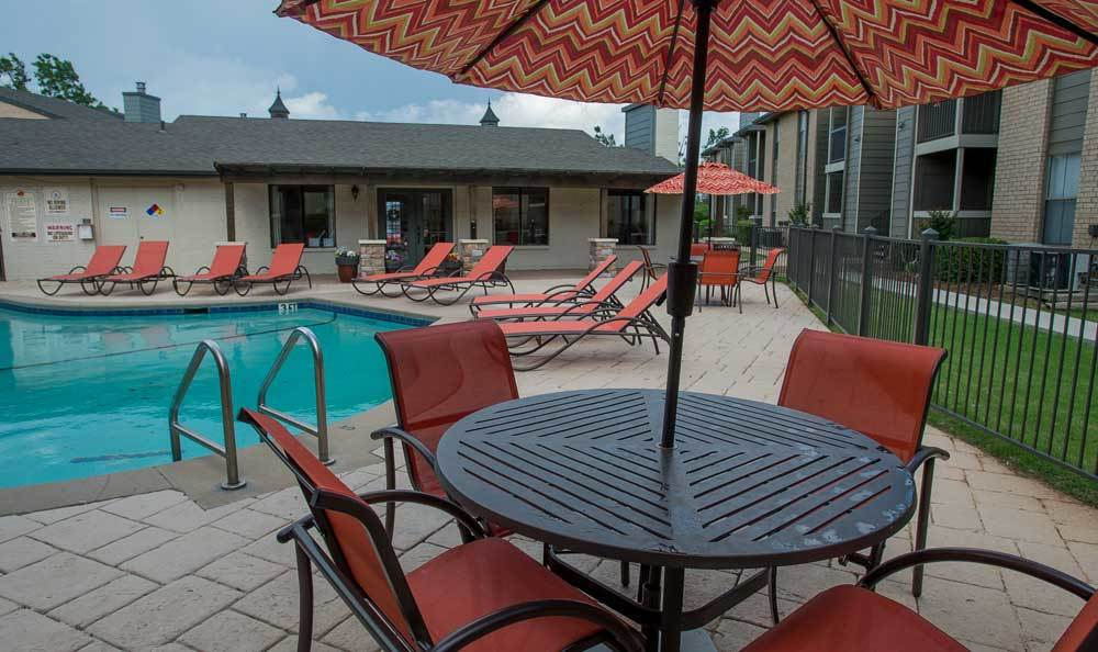 Spend the day at the pool at Cimarron Pointe Apartments