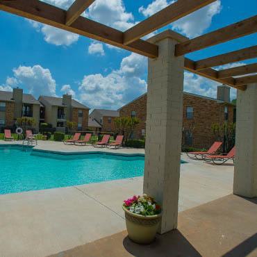 Cimarron Trails Apartments arbor near swimming pool